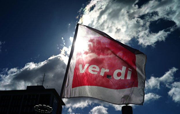 A flag of Verdi is waving during a rally.