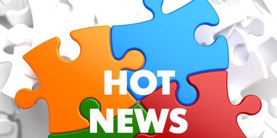 """Puzzle-Teile mit der Aufschrift """"Hot News"""""""