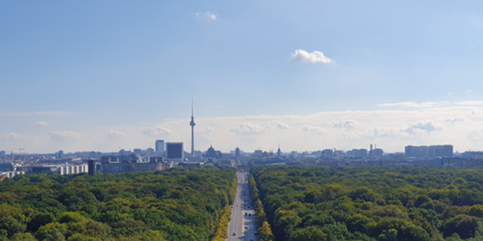 Bird's eye view of Berlin with view of the 17. Juni Street, Tiergarten and Berlin skyline.